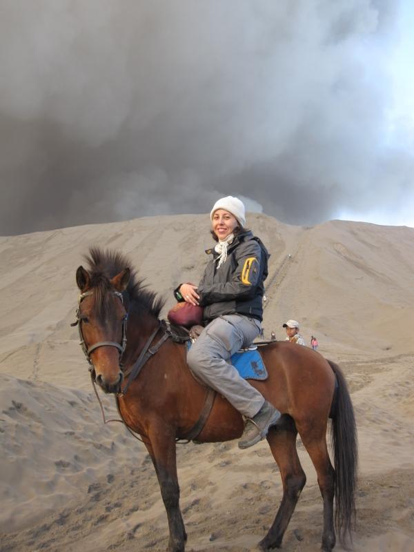 mt-bromo-erupting-behind-maria-on-her-horse