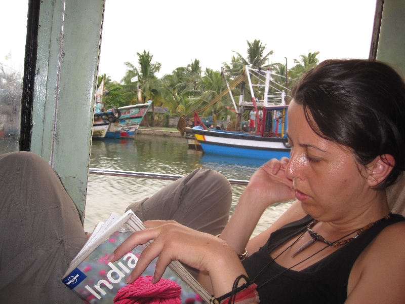 maria-reading-on-the-boat-amritapuri-kollam