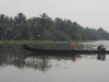 crossing-the-river-with-a-longtailboat