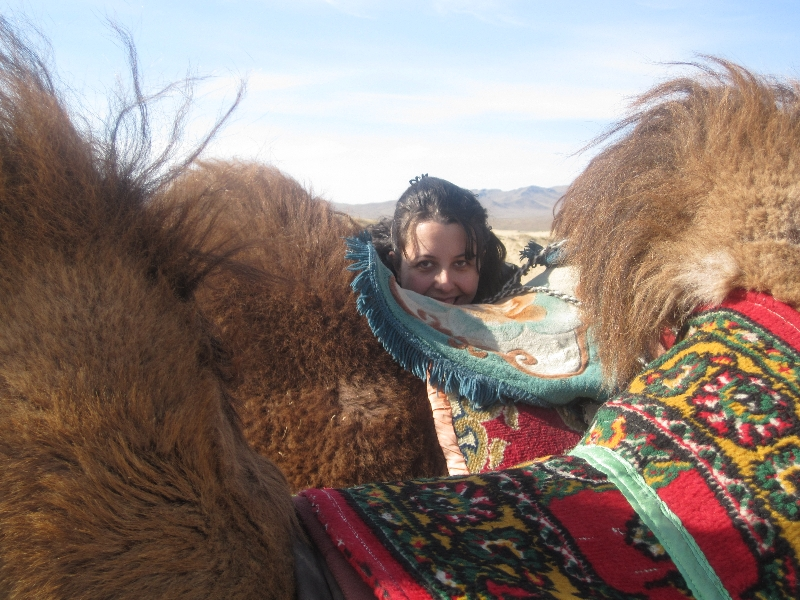 maria-hiding-behind-some-camels