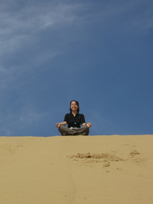 maria-meditating-on-a-sand-dune