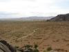 a-car-driving-through-the-mongolian-steppe
