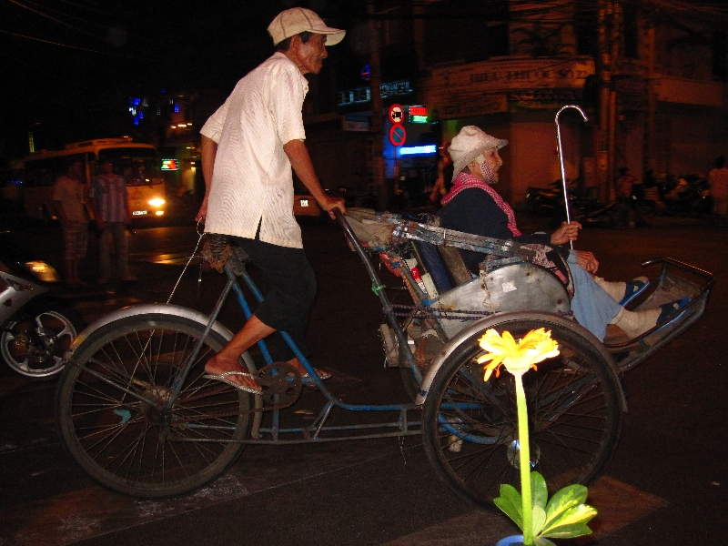 old-woman-riding-a-cyclo