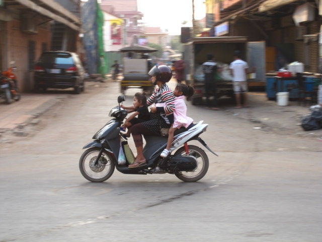 family-driving-through-siam-reap