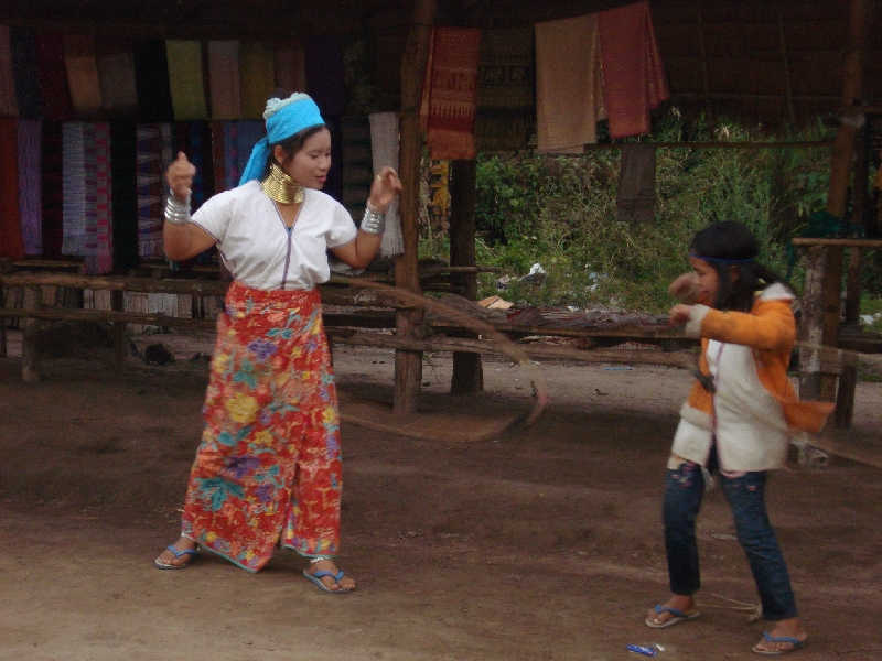 long-neck-girl-and-woman-playing-with-hula-hoop