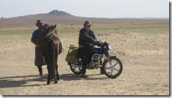 Cowboys in mongolia going by horse or bike