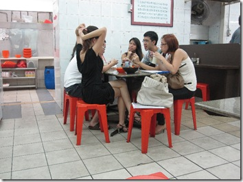 Young singaporians eating