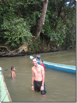 Playing in the river with Iban children