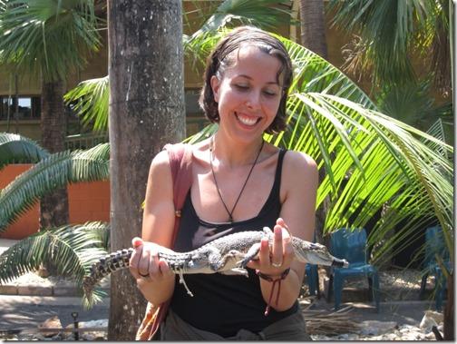 Maria keeping a baby-crocodile